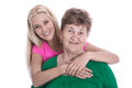 Isolated portrait of blond granddaughter hugging her grandmother real with studio shot Stock Images