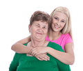Isolated portrait of blond granddaughter hugging her grandmother real with studio shot Stock Photography