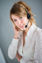 Isolated portrait of cheerful young telephone operator blonde Stock Photography