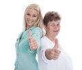 Isolated portrait of happy grandmother and granddaughter with th satisfied granny thumbs up over white studio shot Royalty Free Stock Photography