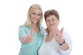 Isolated portrait of happy grandmother and granddaughter with th satisfied granny thumbs up over white studio shot Stock Photos