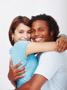 Isolated portrait of a hugging young couple Stock Images