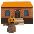 Isolated pumpkin witch in front of house Royalty Free Stock Photo