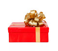 Isolated red gift box with a gold bow on a holiday Stock Photo