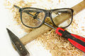 Isolated safety glasses, hammer and screwdriver on Stock Images