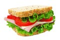 Isolated sandwich ham lettuce and tomato on whole grain bread Stock Photo