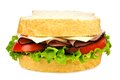 Isolated sandwich with meat tomato lettuce and cheese on white Royalty Free Stock Images
