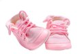 Isolated small pink velvety baby shoes on white over Royalty Free Stock Image