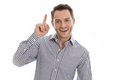 Isolated smiling man with his forfinger pointing a great idea stock photo Stock Photography