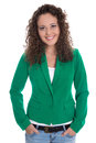 Isolated smiling young business woman in green blazer with jeans curls Royalty Free Stock Photo