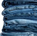 Stack of jeans isolated on white background Royalty Free Stock Photo