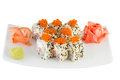 Isolated sushi roll with sasame and salmon roe Royalty Free Stock Photo
