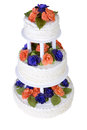 Isolated three tier ruffled cake white wedding decorated with orange and purple roses and green leafs Royalty Free Stock Image