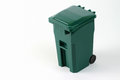 Isolated wheeled green trash can Royalty Free Stock Photo