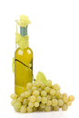 Isolated wine bottle with green grapes Royalty Free Stock Image
