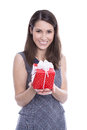 Isolated woman with a red gift box for christmas or valentine happy young present in her hands Stock Photo