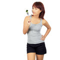 Isolated young asian woman with a picec of brocolli Royalty Free Stock Photos