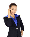 Isolated young business woman has a conversation on a mobile pho phone Royalty Free Stock Photos