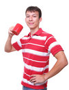 Isolated young man with red coffee cup Stock Image