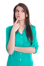 Isolated young pondering female student in green blouse on white thinking teenager with crossed arm Royalty Free Stock Image