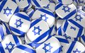 Israel Badges Background - Pile of Israeli Flag Buttons. Royalty Free Stock Photo