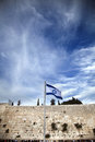 Israel flag fluttering wind front holy wailing wall one most sacred places to jewish people Stock Images