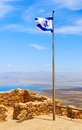 Israel flag over fortress masada Royalty Free Stock Photo