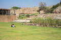 ISRAEL -July 30, - Two teen girl sitting on the grass in the ancient Park of Caesarea, Israel - Caesarea 2015 - Caesarea 2015 Royalty Free Stock Photo