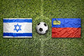 Israel vs. Liechtenstein flags on soccer field Royalty Free Stock Photo