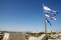 Israeli flag flags are waving over the david s citadel with jerusalem town in the background jerusalem israel Royalty Free Stock Photos
