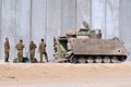 Israeli soldiers and armored vehicle nachal oz july a moving heavily personnel carrier m on july in nachak oz israel it s us made Royalty Free Stock Photography