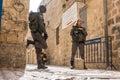 Israeli soldiers - man and woman - guarding Jerusalem Royalty Free Stock Photo
