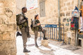 Israeli soldiers - man and woman - guarding Jerusalem Royalty Free Stock Photo