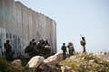 Israeli soldiers and separation wall Stock Photo