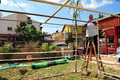 Israelis are preparing for the jewish holiday sukkoth sderot isr oct israeli man builds a sukkah on oct sukkot commemorates time Royalty Free Stock Photos