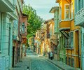 Istanbul old street turkey september people walking on with traditional wooden houses and filigree sidewalk in golden horn Stock Photo