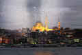 Istanbul after rain view of the mosque with evening lights through the window Stock Photography