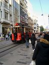 stock image of  Istanbul streets with famous red tram and walking people