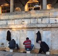 Turkey, Istanbul, Muslim men perform ablutions outside mosque