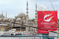 Istanbul turkey april turkish people fishing on the galata bridge with the new mosque and an advert for istanbuls bid for olympic Royalty Free Stock Images