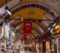 ISTANBUL, TURKEY - MAY, 22, 2019: grand bazaar interior with flags on the ceiling in istanbul Royalty Free Stock Photo
