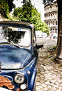 Italia rome old blue car at the center of near the coliseum Stock Images
