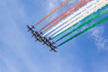 Italian acrobatics the acrobatic jet squad named frecce tricolori doing tricks in the sky Royalty Free Stock Photo