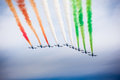 Italian airshow the acrobatic jet squad named frecce tricolori doing tricks in the sky Royalty Free Stock Photo