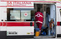 Italian ambulance. Red cross with nurse. Side view Royalty Free Stock Photo