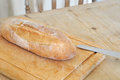 Italian bread on weathered wooden cutting board selective focus Royalty Free Stock Photography