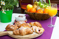Italian breakfast in cafe table with served croissants fesh orange juice and coffee Stock Photo