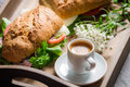 Italian breakfast with espresso and sandwich on old wooden table Royalty Free Stock Image