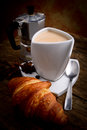 Italian breakfast with milk coffee and croissant Stock Image