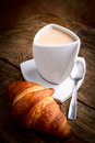 Italian breakfast with milk coffee and croissant Royalty Free Stock Photos